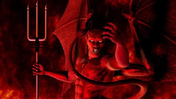 De ce este reprezentat Satana cu coarne, cu încălțăminte de culoare roșie și cu o furcă?